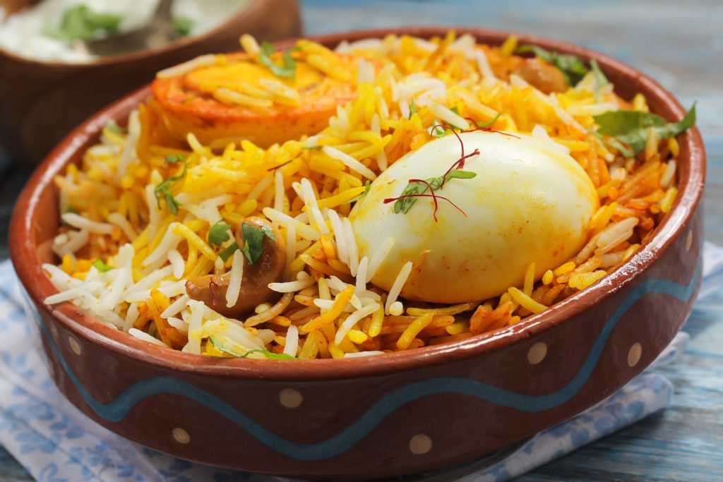 Indian egg Biryani dish coloured yellow with saffron